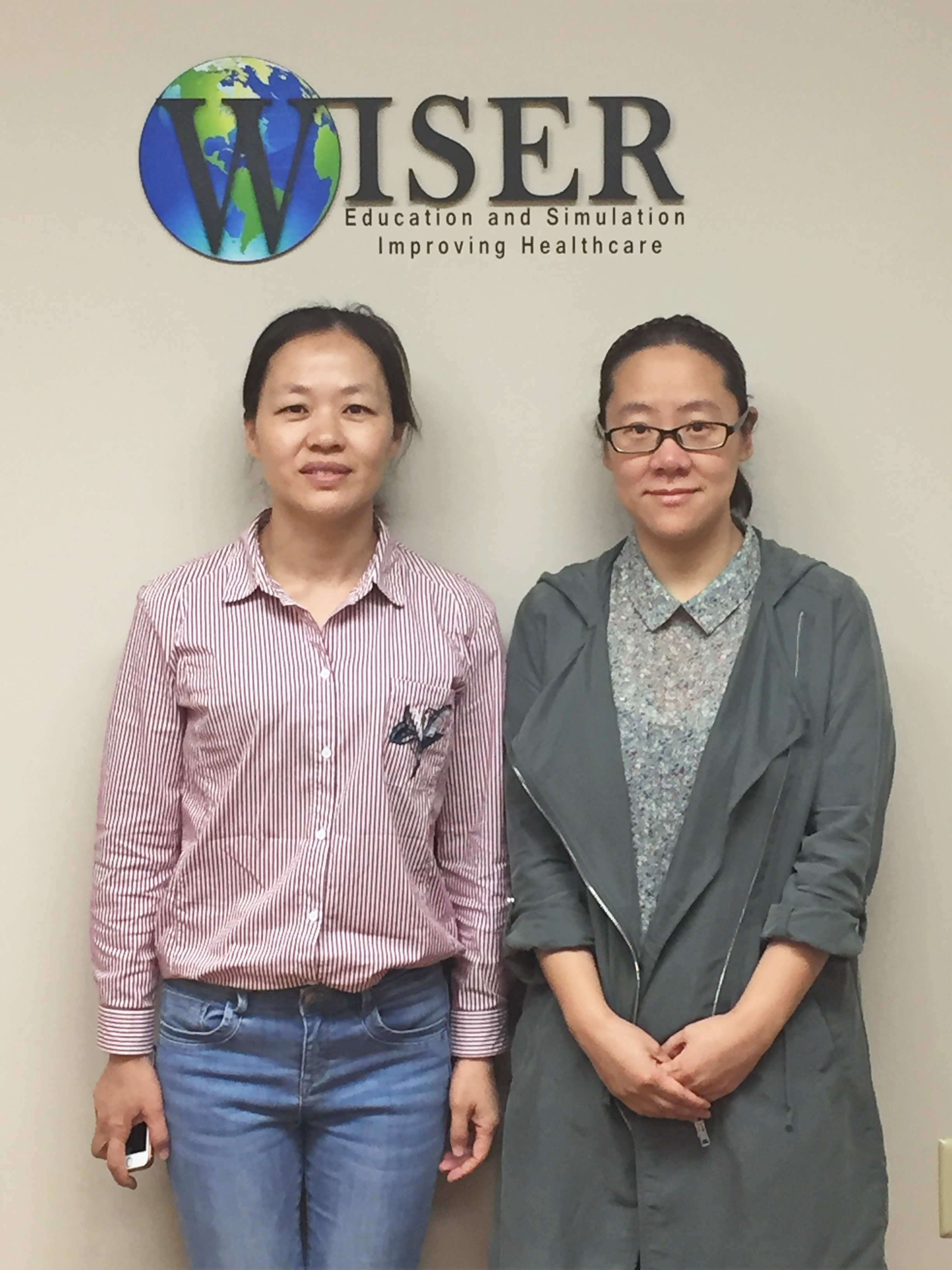 Dr. Bo Yu (left) Dr. Wei Li (right)